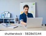 web designer working on laptop... | Shutterstock . vector #582865144