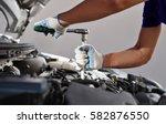 Small photo of Mechanic working in auto repair garage. Car maintenance