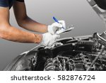 auto mechanic checking car...   Shutterstock . vector #582876724
