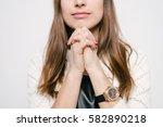 prayer. female. | Shutterstock . vector #582890218