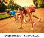 group of  runners in start... | Shutterstock . vector #582905623