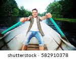 young handsome man swims on a... | Shutterstock . vector #582910378