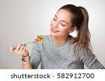 beautiful young brunette woman... | Shutterstock . vector #582912700