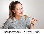 gorgeous young brunette woman... | Shutterstock . vector #582912706