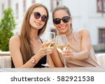 portrait of two young brunettes ... | Shutterstock . vector #582921538
