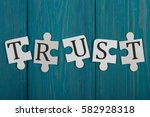 "puzzle pieces with word ""trust"" ... 