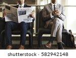 business men break sit read...   Shutterstock . vector #582942148