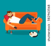 young man lying on the couch ... | Shutterstock .eps vector #582963568
