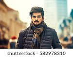 young handsome man is enjoying... | Shutterstock . vector #582978310