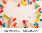 top view on child's hands... | Shutterstock . vector #582985204