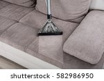 closeup of woman cleaning sofa... | Shutterstock . vector #582986950