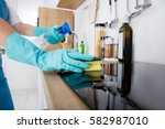 janitor cleaning kitchen... | Shutterstock . vector #582987010