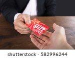 close up of a businessperson... | Shutterstock . vector #582996244