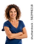 Small photo of Smiling middle aged woman with arms folded, isolated on white background
