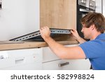 young man in overall installing ...   Shutterstock . vector #582998824