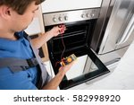 young male technician checking... | Shutterstock . vector #582998920