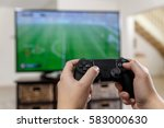 man playing video game. hands...   Shutterstock . vector #583000630