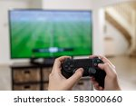 man playing video game. hands... | Shutterstock . vector #583000660