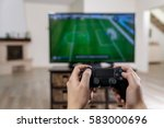 man playing video game. hands... | Shutterstock . vector #583000696