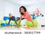 fit caucasian female athletes... | Shutterstock . vector #583017799