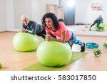 two happy sportswomen... | Shutterstock . vector #583017850