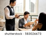 Cheerful Couple With Menu In A...