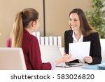 boss attending to an employee... | Shutterstock . vector #583026820
