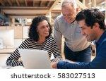 smiling coworkers talking...   Shutterstock . vector #583027513