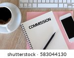 Small photo of Business concept - Top view notebook writing Commission