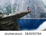 young man climber in red jacket ... | Shutterstock . vector #583050784