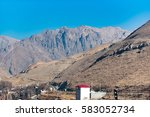 Small photo of Small building afore high mountains