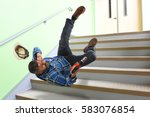 hispanic worker falling on... | Shutterstock . vector #583076854