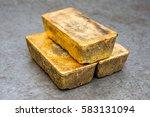 a few golden ingots | Shutterstock . vector #583131094