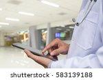 doctor using digital tablet... | Shutterstock . vector #583139188