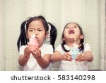 two asian little girl having... | Shutterstock . vector #583140298