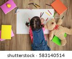 little asian girl drawing in... | Shutterstock . vector #583140514
