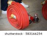 fire hose | Shutterstock . vector #583166254