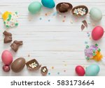 easter eggs on a white wooden... | Shutterstock . vector #583173664