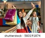 girl makin selfie at mall | Shutterstock . vector #583191874