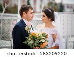 wedding couple stay on the pier ... | Shutterstock . vector #583209220