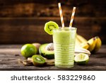 green smoothie kiwi banana and... | Shutterstock . vector #583229860