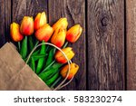 bouquet of tulips in a paper... | Shutterstock . vector #583230274