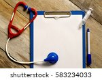 wooden table with stethoscope ... | Shutterstock . vector #583234033