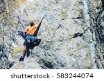Rock Climber Reaching For His...
