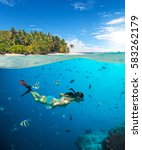 young woman snorkeling on... | Shutterstock . vector #583262179