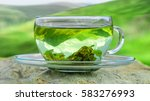 Tea Green Cup With Tea Leaves.