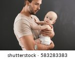 military father hugging his... | Shutterstock . vector #583283383