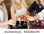 hands holding the glasses of... | Shutterstock . vector #583286194