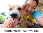 Stock photo woman selfie with dog 583290133