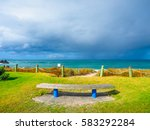 empty bench on the beachfront... | Shutterstock . vector #583292284